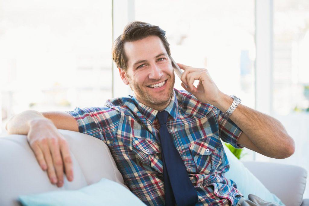 man happily taking calls